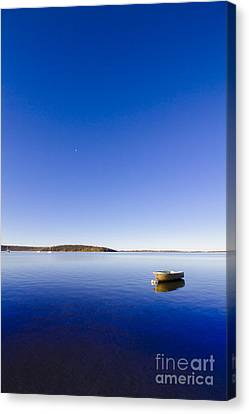 Small Boat Anchored Out To Sea Canvas Print by Jorgo Photography - Wall Art Gallery