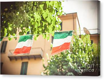 small Italian flags hanging by a thread Canvas Print by Luca Lorenzelli