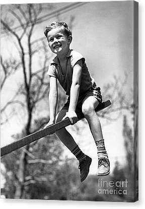 Smiling Boy On Seesaw, C.1930s Canvas Print by H. Armstrong Roberts/ClassicStock