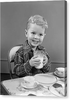 Smiling Boy With Glass Of Milk, C.1950s Canvas Print by H. Armstrong Roberts/ClassicStock