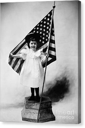 Smiling Little Girl With Us Flag Canvas Print by H. Armstrong Roberts/ClassicStock