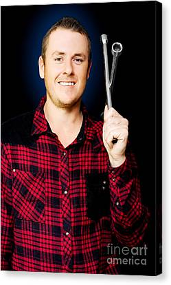 Smiling Mechanic With A Lug Wrench Canvas Print by Jorgo Photography - Wall Art Gallery