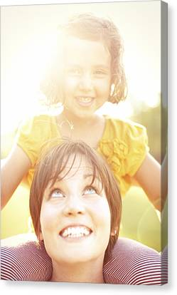 Smiling Mother Holding Daughter Canvas Print by Gillham Studios