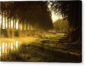 Smoking River Canvas Print by Martin Podt