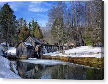 Snow At Mabry Mill Canvas Print by Steve Hurt