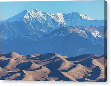 Snow Covered Rocky Mountain Peaks With Sand Dunes Canvas Print by James BO Insogna