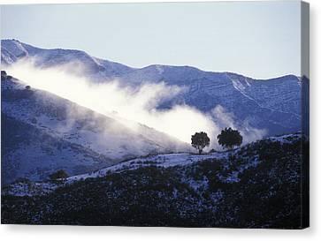 Snow Covered Santa Ynez Mountains Canvas Print by Rich Reid