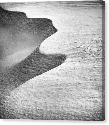 Snow Drift And Shadow Canvas Print by Steve Spiliotopoulos