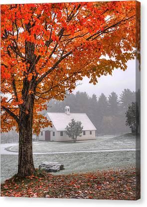 Snow Dust Over Autumn Foliage Canvas Print by Joann Vitali