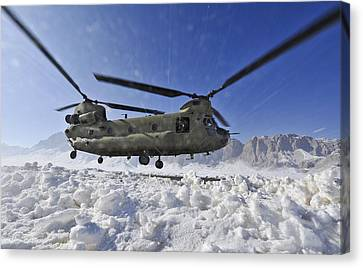 Snow Flies Up As A U.s. Army Ch-47 Canvas Print by Stocktrek Images