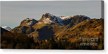 Snow On The Langdales Canvas Print by John Collier
