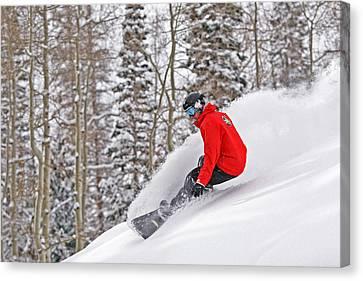 Snowboarder Enjoying Deep Fresh Powder At Brighton Ski Resort. Canvas Print by Paul Kennedy