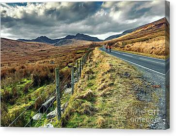 Snowdon Cyclists Canvas Print by Adrian Evans