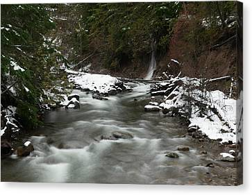 Snowfall On Hood River Canvas Print by Jeff Swan