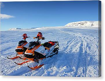Snowmobiles In Iceland In Winter Canvas Print by Matthias Hauser