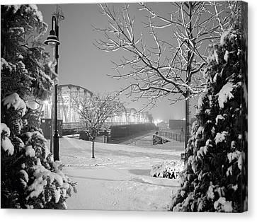 Snowy Bridge With Trees Canvas Print by Jeremy Evensen