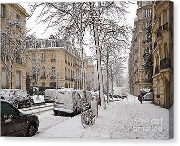 Snowy Day In Paris Canvas Print by Louise Heusinkveld