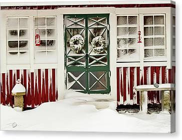 Snowy Doors Canvas Print by Torbjorn Swenelius