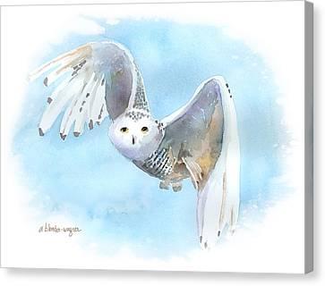Snowy Owl In Flight Canvas Print by Arline Wagner