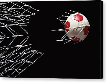 Soccer Ball Breaking Through Goal Net Canvas Print by Phillip Simpson Photographer