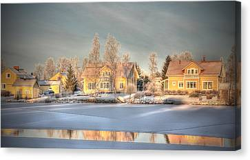 Finland Canvas Print - Soft Yellow Wooden Houses In Sunset Light Finland by Sandra Rugina