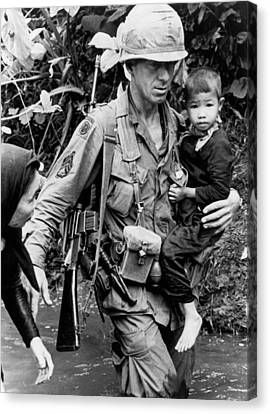 Soldier Carrying Boy Canvas Print by Underwood Archives
