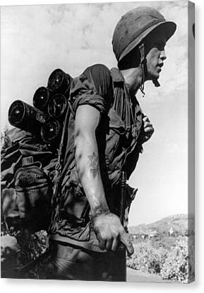 Canteen Canvas Print - Soldier With A Heavy Load by Underwood Archives