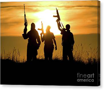Soldiers Against A Sunset Canvas Print by Oleg Zabielin