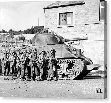 Soldiers And Their Tank Advance Canvas Print by Stocktrek Images
