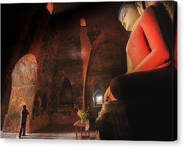 Southeast Asian Man Praying  Canvas Print by Anek Suwannaphoom
