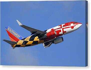 Southwest Airlines Boeing 737-7h4 N214wn Maryland One Phoenix Sky Harbor December 23 2010 Canvas Print by Brian Lockett