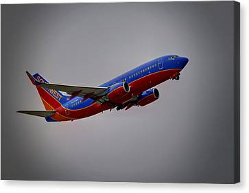 Southwest Departure Canvas Print by Ricky Barnard