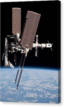 Space Shuttle Endeavor Docked Canvas Print by Everett