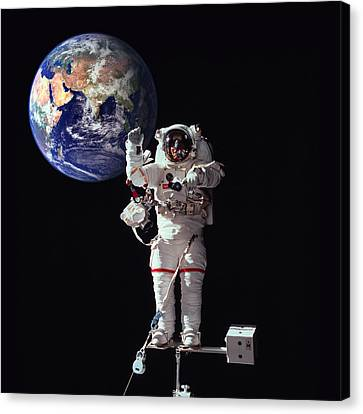 Spacewalk Earth Canvas Print by Daniel Hagerman