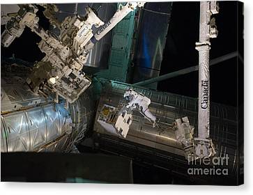 Spacewalk On Iss Canvas Print by NASA/Science Source