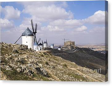 Spanish Windmills And Castle Of Consuegra Canvas Print by Perry Van Munster