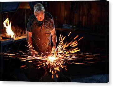 Red Fireworks Canvas Print - Sparks When Blacksmith Hit Hot Iron by Johan Swanepoel