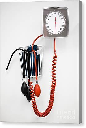 Sphygmomanometer Blood Pressure Gauge In A Doctor's Office Canvas Print by Paul Velgos