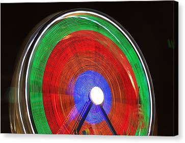 Spinning Wheels Canvas Print by James BO  Insogna