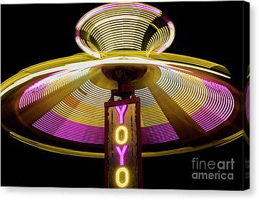 Spinning Yoyo Ride Canvas Print by Juli Scalzi