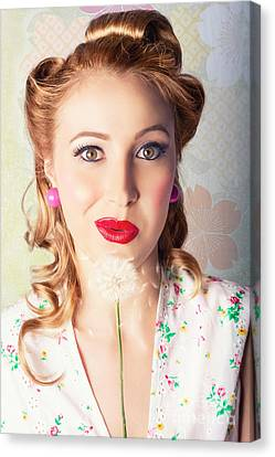 Spring Beauty. Beautiful Retro Girl Blowing Flower Canvas Print by Jorgo Photography - Wall Art Gallery