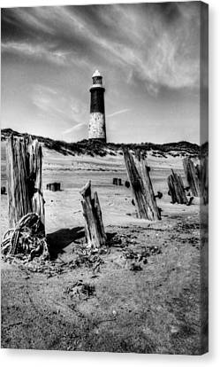 Spurn Point Lighthouse And Groynes Canvas Print by Sarah Couzens