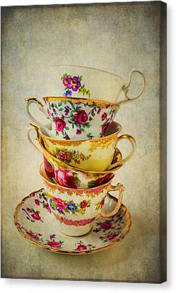 Stack Of Pretty Tea Cups Canvas Print by Garry Gay