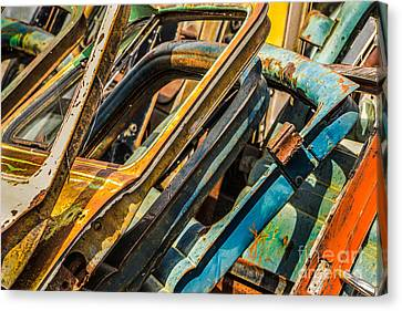 Stack Of Rusty Car Doors Canvas Print by Jerry Fornarotto