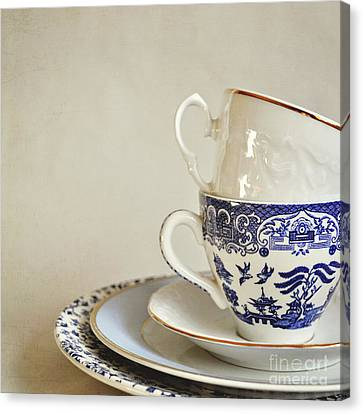 Stacked Blue And White China Cups And Saucers. Canvas Print