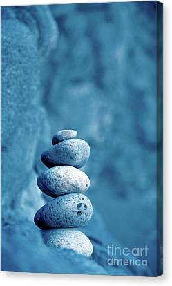 Stacked Pebbles Canvas Print by Gaspar Avila