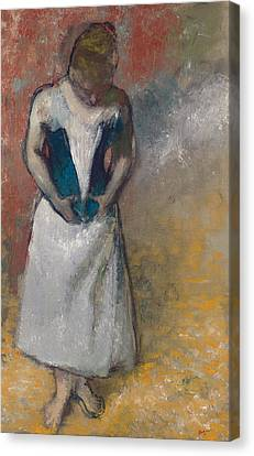 Standing Woman Seen From The Front, Clasping Her Corset Canvas Print by Edgar Degas