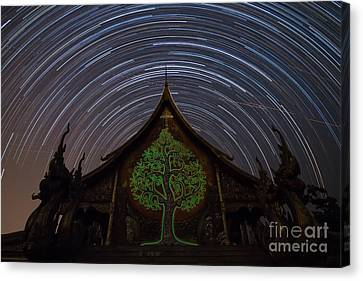 Canvas Print featuring the photograph Star Trails In The Night At Temple by Tosporn Preede