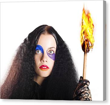 Staring Woman Holding Flame Torch Canvas Print