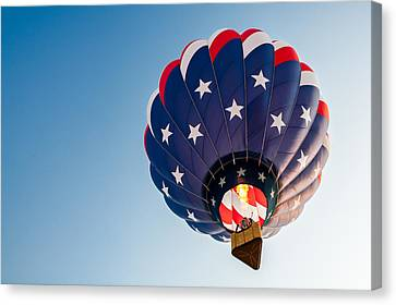 Stars And Stripes Above Canvas Print by Todd Klassy